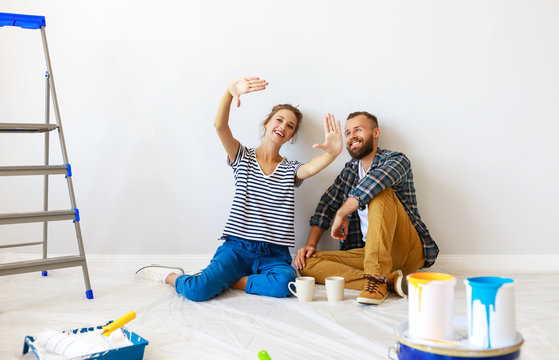 young happy family married couple dreams of renovating  house and planning  design project.
