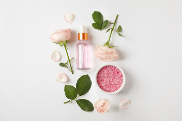 Composition with rose essential oil on white background, top view Wall mural