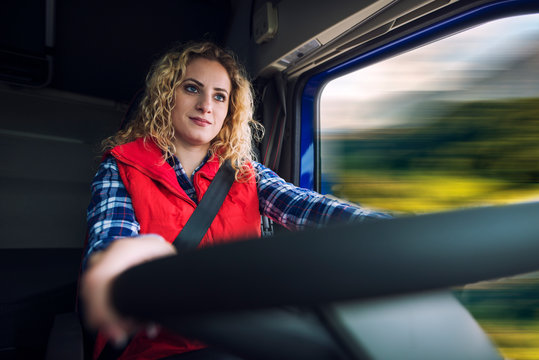 Truck driver occupation. Woman driving truck vehicle. Transportation service.