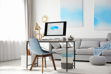 Comfortable workplace with modern computer on desk. Home office