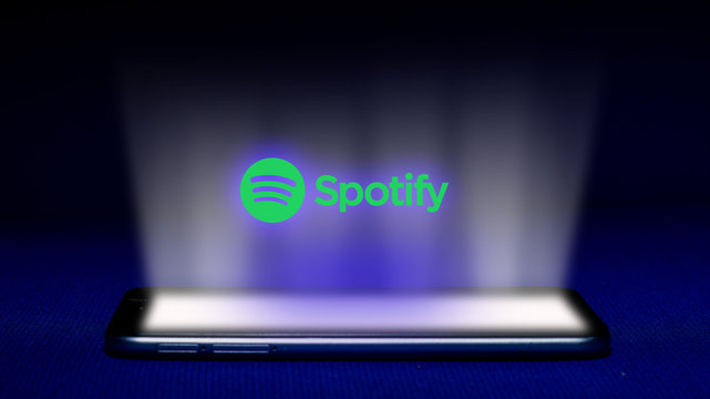 Magelang, Central Java, Indonesia, April 29, 2019. Hologram of spotify  logo. hologram spotify logo image on blue background . The concept of next technology, a new generation of listen music  - Image