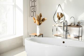 Modern ceramic bathtub in light interior