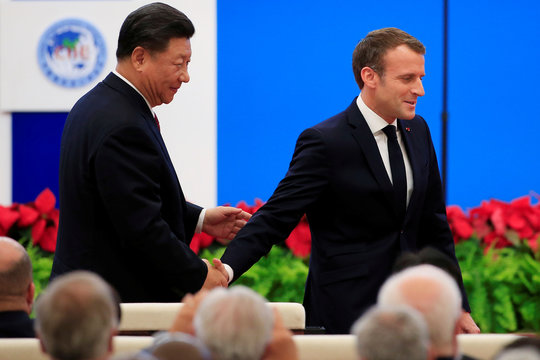 French President Emmanuel Macron shakes hands with Chinese President Xi Jinping following his speech at the opening ceremony of the second China International Import Expo (CIIE) in Shanghai