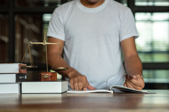 Legal concept of law Lawyers read legal documents and agreements on office desks.