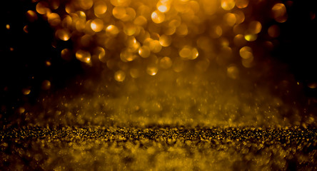 Twinkling golden glitter falling gold background