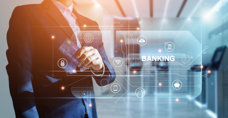 Banking network, Businessman and credit card in hand and word banking with icon network connection on virtual screen, online payment, financial futuristic and technology, credit card are design up.
