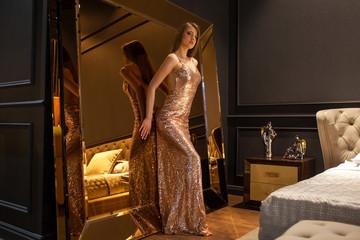 Glamorous interior golden mirror. Fashion Beautiful young woman Wall mural