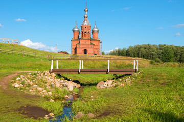 The first bridge over the source of the Volga River. Volgoverkhovye Olginsky convent, Church Transfiguration in Tver Region, Russia