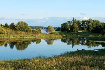 Lake on the outskirts of the village on a summer evening at sunset