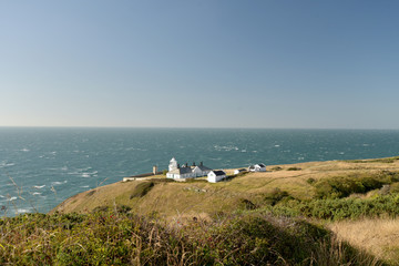 Lighthouse beside the coastal path near Durlston Castle on the Dorset coast
