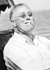 President Franklin Roosevelt smokes a cigarette while fishing for tarpon during his vacation on the Gulf of Mexico