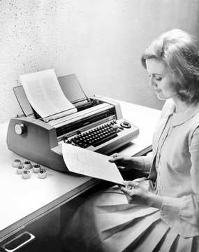 """IBM's State of the Art Selectric typesetting unit justifies type semi-automatically."""", u""""The Selectric line was an advanced 'typewriter' design before the computerized word processing ushered in its obsolescence in the 1980s"""