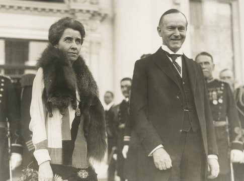 President Calvin and First Lady Grace Coolidge at the 1928 White House New Year's reception. Everyone from the common citizen to the highest-ranking diplomat was welcomed and the line snaked out beyond the gates White House