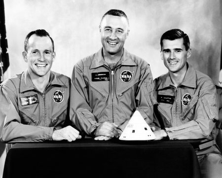 The crew of the first manned Apollo space flight, all of whom were killed in a fire at Cape