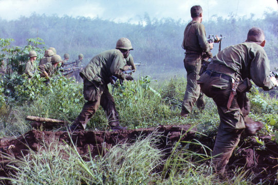 Vietnam War, Dak To, South Vietnam, an infantry patrol moves up to assault the last Viet Cong position after an attempted overrun of the artillery position by the Viet Cong during Operation Hawthorne, circa late 1960s