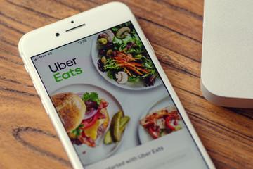Guilherand-Granges, France - November 04, 2019. Apple Iphone 8 with online food ordering and delivery platform app logo: Uber Eats.