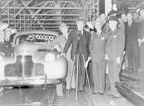 William S. Knudsen (1879-1948), presided over the 25,000,000th car to come off the General Motors