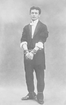 Harry Houdini (1874-1926), in chains