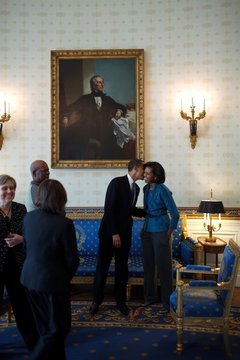 President Obama kisses First Lady Michelle Obama in the Blue Room prior to meeting with the Congressional Black Caucus in the State Dining Room of the White House Feb. 26 2009