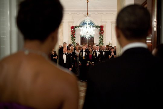 President and Michelle Obama face White House guests before making their entrance to a Kennedy Center Honors reception on Dec. 6 2009