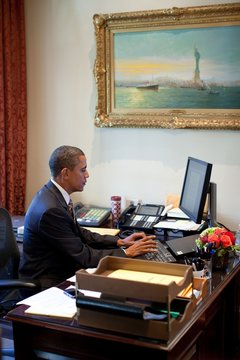 President Barack Obama does last-minute edit of a speech at the desk of Personal Secretary Katie Johnson in the Outer Oval Office Oct. 8 2010
