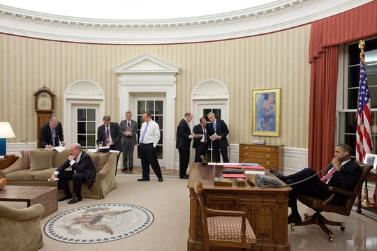 President Obama talks on the phone with Egyptian President Hosni Mubarak as senior staff and national security team listen and work in the background