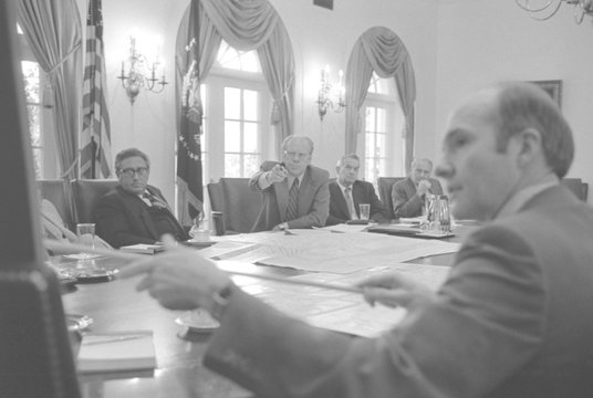 President Gerald Ford and National Security Adviser Brent Scowcroft point to a map of Beirut following the assassinations of the US Ambassador and an economic counselor.At Ford's left is Sec. of State Henry Kissinger