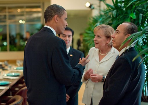President Obama talks with German Chancellor Angela Merkel and Mexican President Felipe Calderon during a G-20 summit working dinner in Pittsburgh