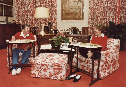 President and Nancy Reagan eating on TV trays in the White House living quarters