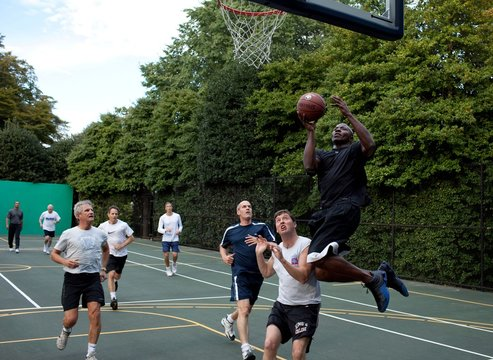 Reggie Love President Barack Obama's personal aide drives to the basket during a game with members of Congress and Cabinet secretaries on the White House basketball court Oct. 8 2009