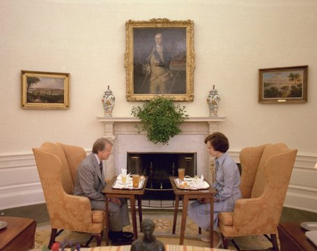 Jimmy Carter and Rosalynn Carter having one of their weekly working lunches in the Oval Office. At