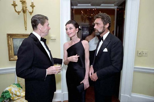 President Reagan talking with Audrey Hepburn and Robert Wolders at a private dinner for the Prince of Wales at the White House, May 2 1981