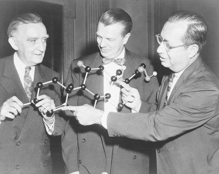 Scientists with a model of the molecular structure of cortisone. Senator Joseph O'Mahoney (center)
