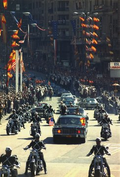 President Nixon waves to the crowd during a motorcade through Madrid Spain