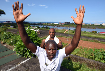 Sergent Johnny Senghe strikes a yoga pose in Freetown