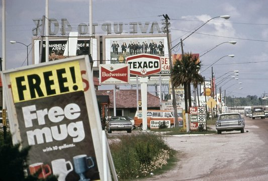 Billboards and advertising clutter a road in Real County Texas