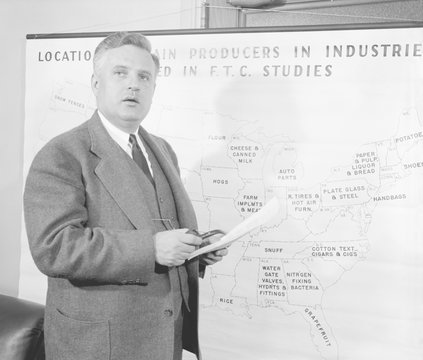 Economist Willis J. Ballinger with map showing state's industries, March 1939. (bsloc_2013_7_126)
