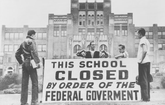 Little Rock Central High was closed to avoid integration.Four students pose with a large sign reading 'This school closed by order of the federal government.' The city government closed the school for the 1958-59 academic year rather than continue racial