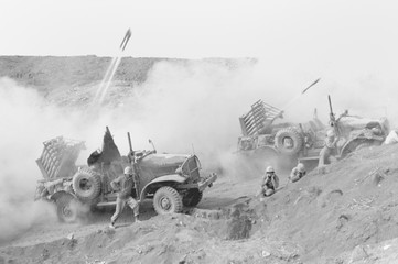 Marines launch rockets toward Japanese positions to support U.S. soldiers on Iwo Jima. The mobile