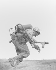 Marine with a flame-thrower, running to assault a Japanese pillbox on Motoyama Airfield Number Two