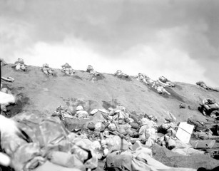 5th Division Marines crawl up a slope on Red Beach No. Suribachi on Iwo Jima, Feb. 19, 1945, World War 2