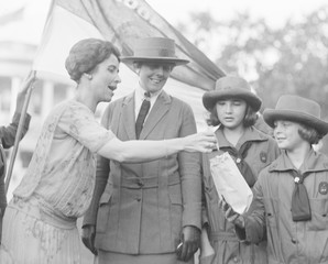 First Lady Grace Coolidge enthusiastically samples Girl Scout Cookies