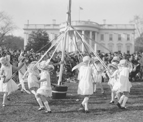 Children dance around a maypole at the White House Easter Celebration on April 1, 1929