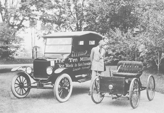 Henry Ford stands between the first and ten millionth Ford, June 4, 1924