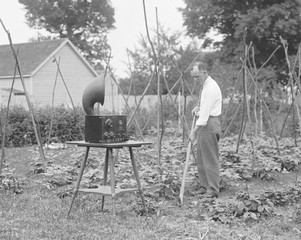 W.D. Terrell gardening with a radio nearby, July 7, 1926. Terrell was Chief Supervisor of Radio