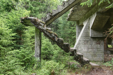 Abandoned rest of the concrete staircase in the woods