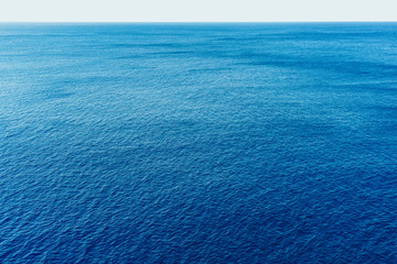 Blue sea surface with waves aerial view