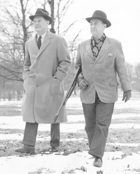 From left: National Democratic Chairman Steve Mitchell and Adlai Stevenson on the grounds of Stevenson's home near Libertyville, Illinois, January 6, 1954