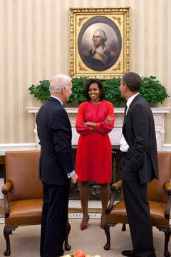 President Obama and VP Joe Biden talk with First Lady Michelle Obama in the Oval Office