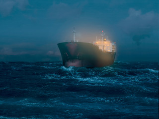 Illuminated tanker on the sea during the night